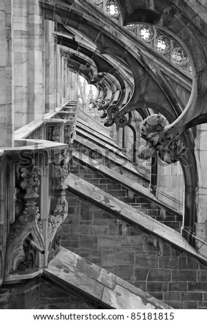 Detail of the gothic duomo in Milan, Italy - in black and white. #85181815
