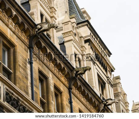 Detail of the house in Cambridge, United Kingdom. Gargoyles to convey water from a roof and away from the side of a building  preventing rainwater from running down masonry walls and eroding it