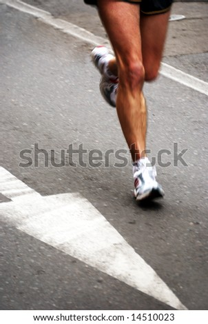 detail of the legs of a marathon runner with slight panning effect
