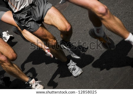 detail of the legs of marathon runners