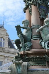 Detail of the Limoges Cityhall fountain. A young boy is drawing. France, June 2021.