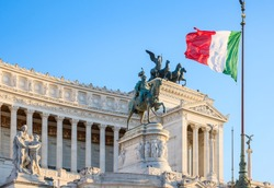 Detail of the Monumento Nazionale a Vittorio Emanuele II in Rome under the Italian national flag. Rome, Italy