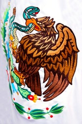 Detail of the official Mexican flag. In the Mexican flag appears an eagle devouring to a snake. An ancient legend of the prehispanic world indicates this image as the foundation of Mexico.