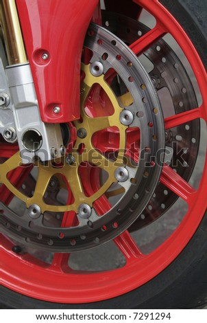 Detail of the red front wheel of a motorcycle
