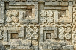 detail of the reliefs of the temple of the big Mayan pyramid in the archaeological Uxmal enclosure in yucatan, Mexico