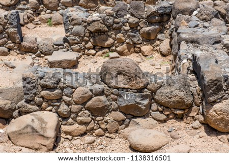 Detail of the ruins of the dark basalt rock village of Capernaum, on the shore of the Sea of Galilee, where Jesus and St Peter lived and met Andrew, James, John and Matthew