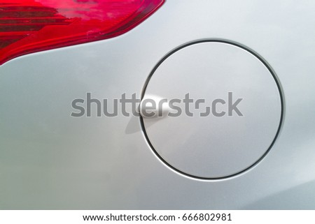 Detail of the silver cap from the tank on the car with silver metallic. Red taillight of a silver car. Сток-фото ©