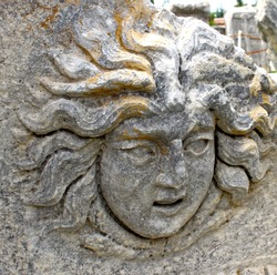 detail of the stone medusa statue