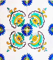 Detail of the traditional tiles from facade of old house. Decorative tiles.Valencian traditional tiles. Floral ornament.