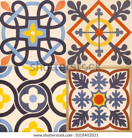 Detail of the traditional tiles from facade of old house. Decorative tiles.Valencian traditional tiles. Floral ornament. #1018402021