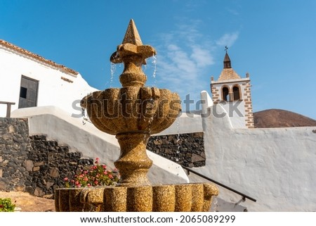 Detail of the water in the fountain next to the white church of Betancuria, west coast of the island of Fuerteventura, Canary Islands. Spain