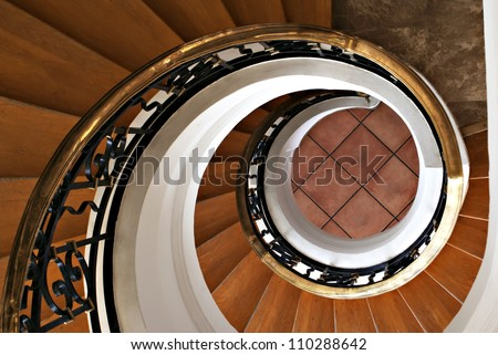 Detail of the wood spiral staircase in the hotel