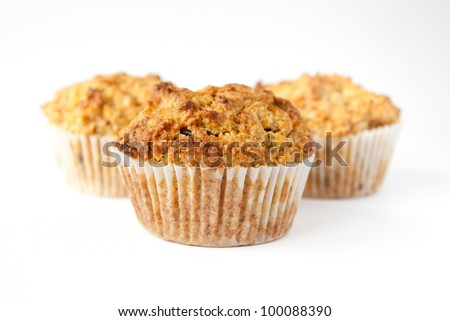 Detail of three gluten free muffins with nuts isolated on white background
