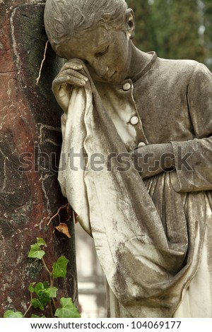 detail of tomb with crying girl statue, monumental cemetery in Italy, Europe - stock photo