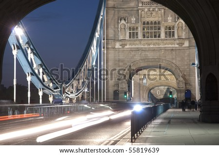 Detail of Tower Bridge in London at dusk with car light trail.