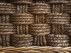 Detail of traditional a braided rope natural texture background for interior design.