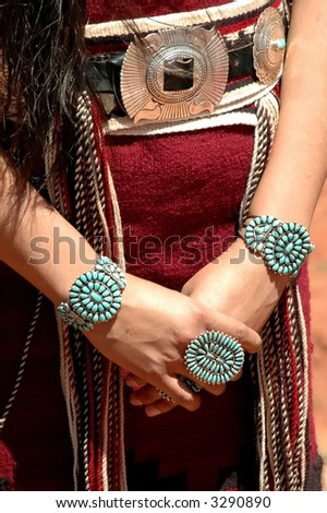 detail of traditional turquoise navajo ceremonial jewelery bracelets, ring and belt