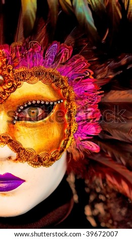 Detail of traditional Venice mask with colorful decoration