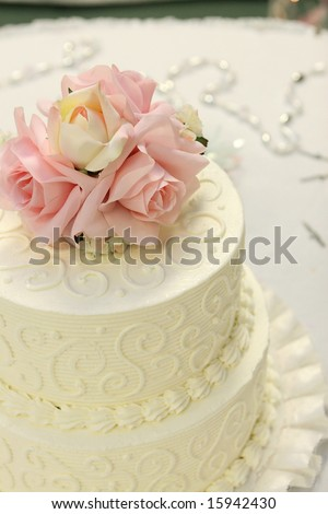 stock photo Detail of traditional wedding cake with pink and cream roses
