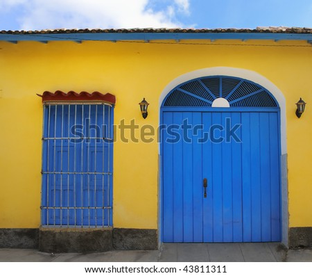 Detail of tropical vintage house facade in yellow and blue at trinidad town, cuba