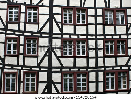 Detail of typical half timbered house in Monschau, Germany. The historic town center has many preserved half-timbered houses and narrow streets have remained nearly unchanged for 300 years