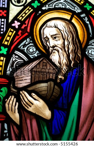 detail of victorian stained glass church window in Fringford depicting Noah with the ark in his arms