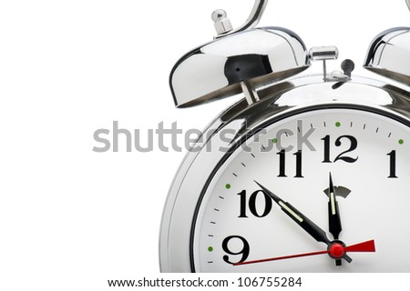 detail of vintage alarm clock on white background