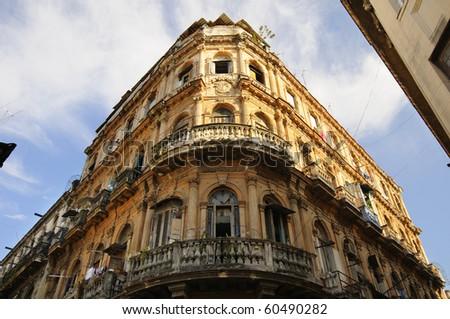 Detail of vintage facade in crumbling Havana building