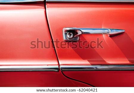 detail of vintage red car door