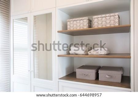 Detail of walk in closet with wardrobe. #644698957
