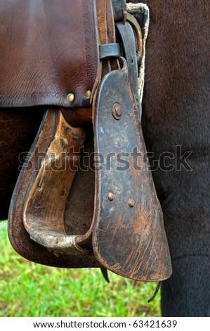Detail of western style stirrup, vertical shot.