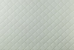 detail of white sewn leather