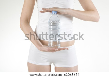 detail of woman holding bottle of  water