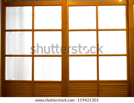 detail of wooden doors with glass.
