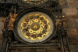Detail on Astronomical Clock (Prague Orloj) located in The clock tower and a dove flying in front of it. Prague, Czech Republic