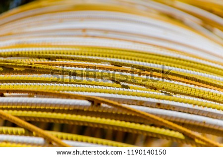 Detail on iron rods painted in yellow and white
