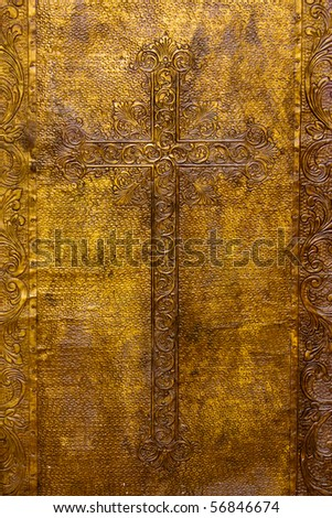 Detail on the golden plated door on the church door. - stock photo