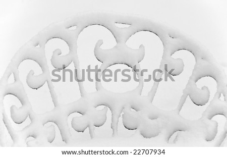 Detail ornament, snow-covered back of a garden chair