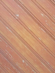 Detail out of a brown wooden surface with parallel lines.