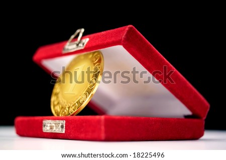 detail shot of a gold medal in a box - stock photo