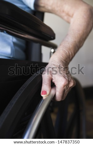 Detail shot of a woman operating wheelchair