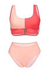 Detail shot of bright two-piece swimsuit composed of coral and pale pink bra with metal buckle and pale pink high-waisted panties. Stylish swimming suit is isolated on the white background.