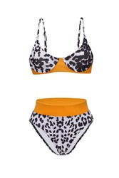 Detail shot of bright two-piece swimsuit with leopard print composed of bra with thin shoulder straps and high-waisted panties. Stylish swimming suit is isolated on the white background.