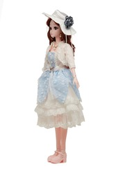 Detail shot of collector's hinged doll in hat with flower, pink shoes, blue and white lace dress and bolero. Brown-haired doll in pearl necklace and earrings is located on the white background.