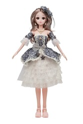 Detail shot of collector's hinged doll in little hat, shoes, gray and white lace dress with floral design, bows and brooch. Blonde doll in necklace and earrings is located on white background.