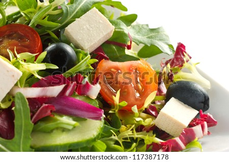 Detail shot of greek salad on a white plate