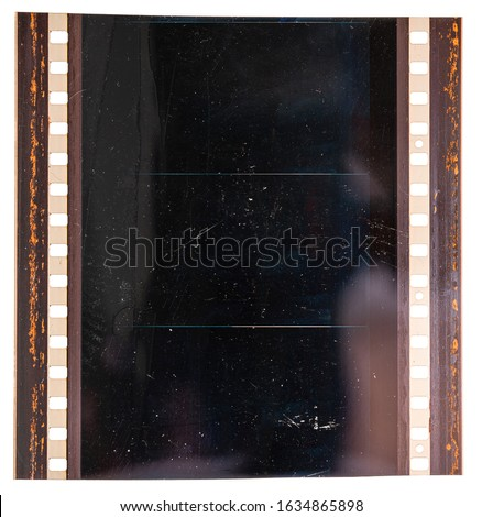 detail shot or macro photo of real blank and exposed 70mm cine film strip or stripe isolated on white background, film material texture.