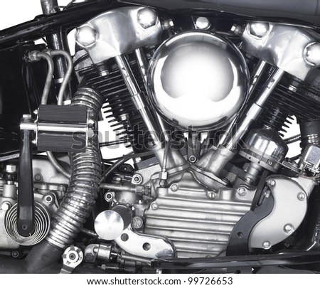 detail shot showing the motor of a motorbike