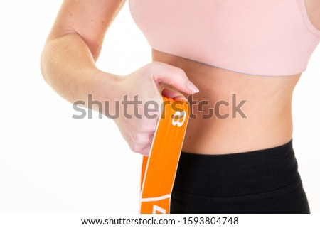 detail slim sporty woman exercising pilates fitness elastic resistant band exercises isolated on white background