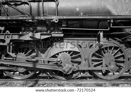Detail take of wheels and transmission of a historic steam locomotive